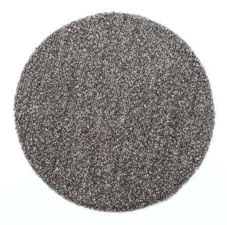 clean carpet: a round grey carpet isolated on white background Stock Photo
