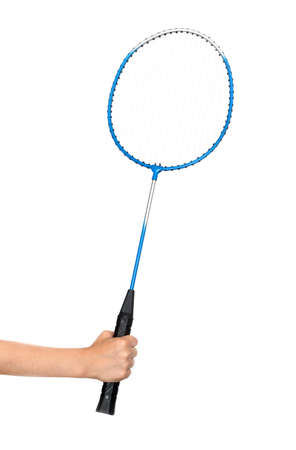 childs hand holding a badminton racket on a white