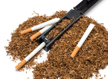 Cigarette rolling machine and empty cigarette tube and tobacco on white background