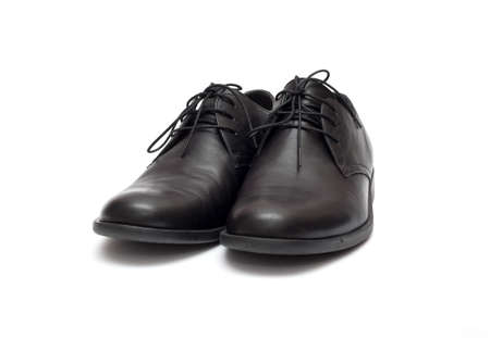 black mens shoes on a white background Stock Photo
