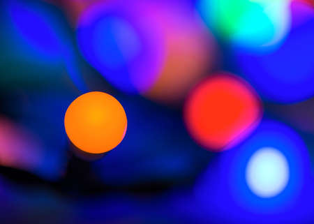 Abstract vibrant bright round bokeh over dark background Stock Photo
