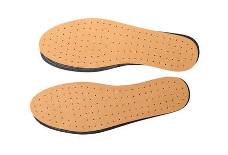Brown insoles for shoes on a white background