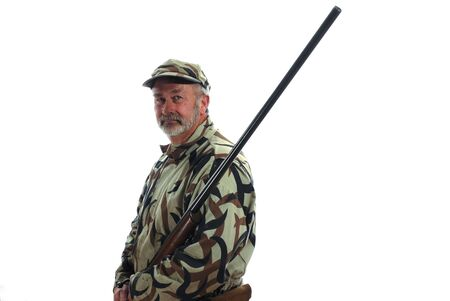 riffle: Hunter in camouflage holding a riffle