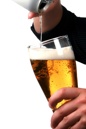 nonalcoholic beer: Hands pouring beer into a stein.