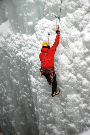 jock: An Ice Climber going up a frozen waterfall.