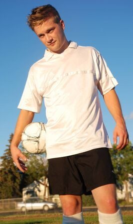 A soccer player in a field Banque d'images