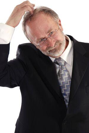 Senior businessman scratching his head