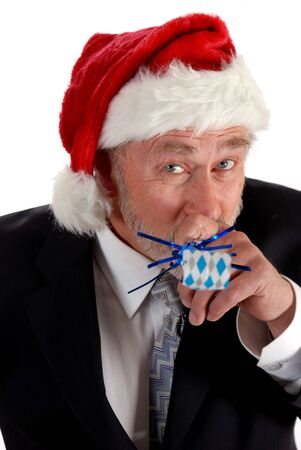 noise maker: Business man in santa hat blowing party blower