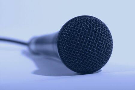 Macro of a microphone, tinted blue.