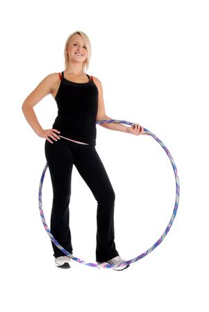 Fit blond woman holding a hoop, fitness theme. Stock Photo - 10214598