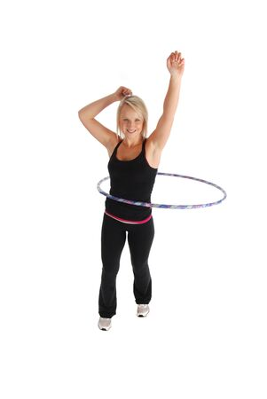 A blond woman exercising using a  hoop  Banco de Imagens