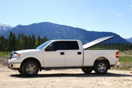 pick up truck: Pick-up truck on a dirt road in the mountains.