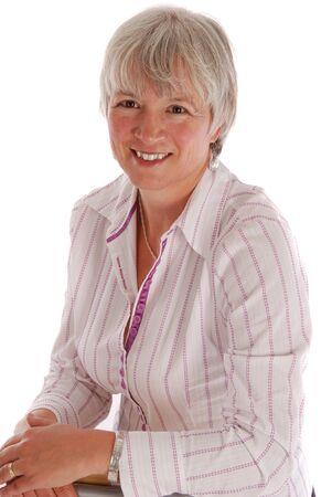 Portret van een senior business vrouw op wit. Stockfoto