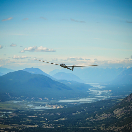 A duodiscus glider flying in the mountains of the Columbia Valley near Invermere, East Kootenay, British Columbia, Canada.