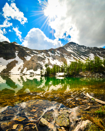 Mountain reflection in alpine tarn, Brewer Creek, Purcell Mountains, British Columbia, Canada