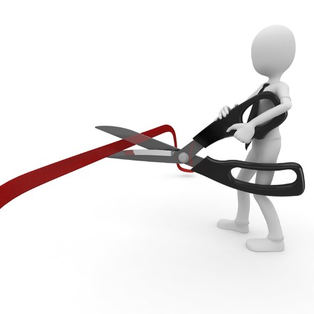 3d man cutting ribbon with scissors isolated on white photo