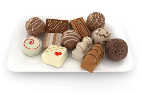 plato del buen comer: Trufas de chocolate en un plato aislados sobre un fondo blanco