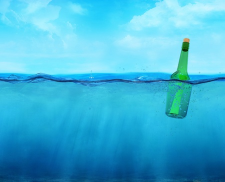 deep sea: 3d floating bottle with message on the ocean waterline view Stock Photo