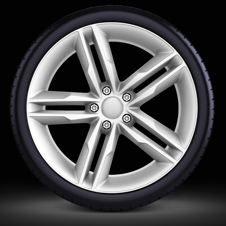 3d detailed car wheel with rim on black  background photo