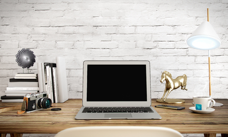 home office desk: 3d laptop computer on a desk in office workspace 3D illustration Stock Photo