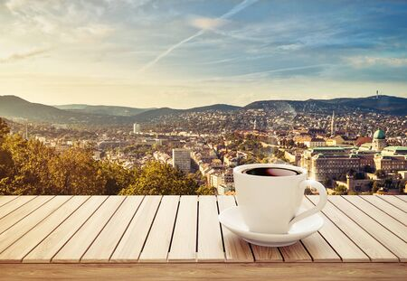 table with cup of coffee on city background 3D illustration