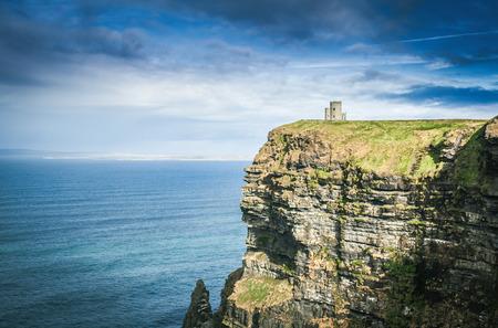 doolin: famous cliffs of moher, castle tower, west coast of ireland at wild atlantic ocean Stock Photo