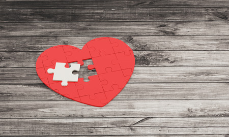pacemaker: red puzzle heart with white piece on wooden background 3D illustration