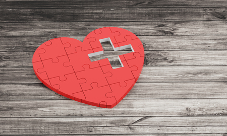 pacemaker: red puzzle heart with white cross on wooden background 3D illustration Stock Photo