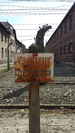 electric fence: Label on electric fence in Nazi concentration camp Auschwitz