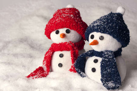 pour feliciter: Photo of three hand made snowman in blue color and red - optimal decoration for christmas, new year, winter scenery