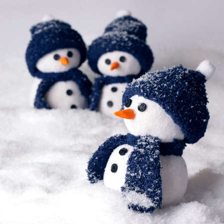 optimal: Photo of three hand made snowman in blue color - optimal decoration for christmas, new year, winter scenery