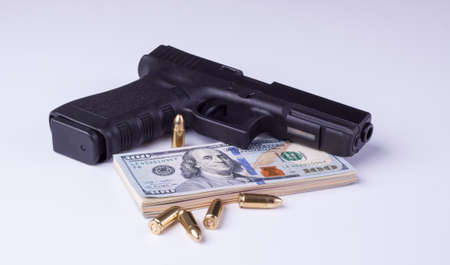 larceny: Black semi-automatic gun with american dollars and projectiles