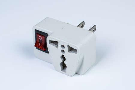 plug socket: the used plug socket adapter on white background