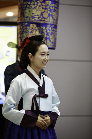 INCHEON, SOUTH KOREA - JULY 01, 2013  Korean woman wearing traditional cloths at Incheon International Airport on July 01, 2013 in South Korea  Incheon Airport is the largest airport in South Korea