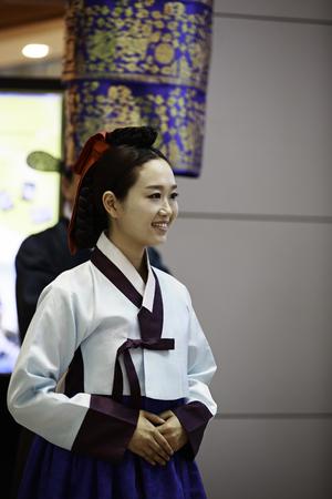 incheon: INCHEON, SOUTH KOREA - JULY 01, 2013  Korean woman wearing traditional cloths at Incheon International Airport on July 01, 2013 in South Korea  Incheon Airport is the largest airport in South Korea