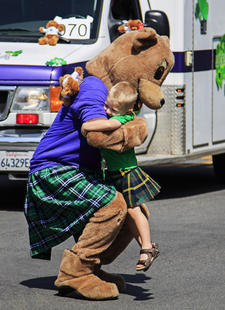 festival moment: San Diego, CA, USA – March 16, 2013  A sweet moment at St  Patrick s Day Parade and Festival on March 16, 2013 San Diego, CA  This event has become one of the largest single-day events in San Diego