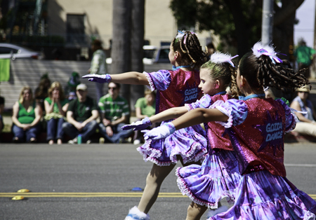 San Diego, CA, USA – March 16, 2013  Group of teenager dancers at St  Patrick s Day Parade on March 16, 2013 San Diego, CA  This event has become one of the largest single-day events in San Diego