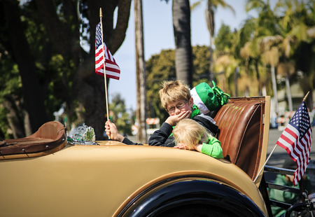 San Diego, CA, USA – March 16, 2013  Kids in a Parade car at St  Patrick s Day Parade on March 16, 2013 San Diego, CA  This event has become one of the largest single-day events in San Diego
