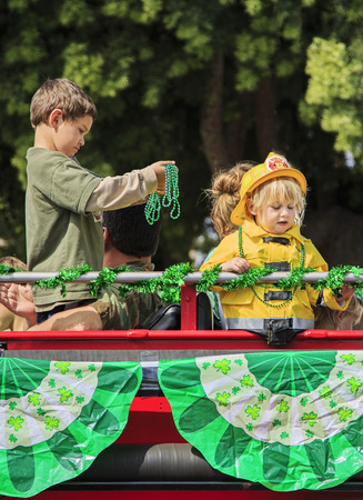 San Diego, CA, USA – March 16, 2013  Kids in fire truck at St  Patrick s Day Parade on March 16, 2013 San Diego, CA  This event has become one of the largest single-day events in San Diego  Redakční