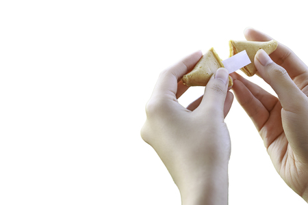 Womans Hands Open a Fortune Cookie
