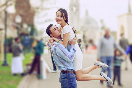 Happy young couple enjoy being outdoor