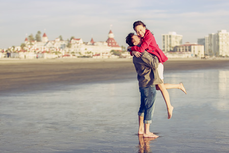Happy young couple having fun at the beach Reklamní fotografie