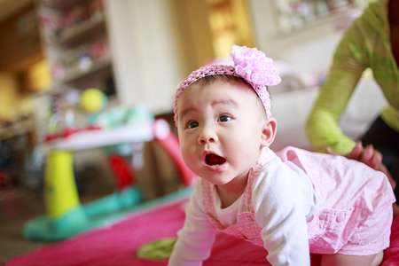 baby girls smiley face: Baby Practice Crawling Stock Photo