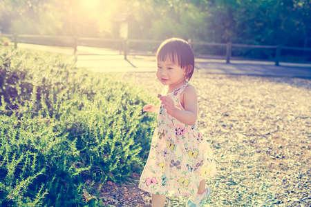 Toddler girl playing outdoor