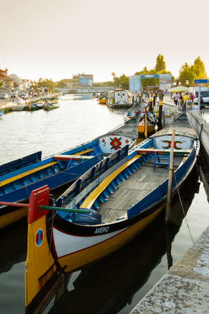 View the traditional moliceiro boats stopped in  the central canal of Aveiro city, in Portugal
