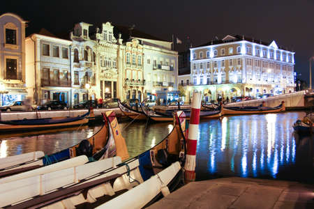 made in portugal: Night view the traditional moliceiro boats stopped in  the central canal of Aveiro city, in Portugal