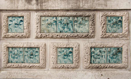modernist: Detail of modernist flowers carving in stone wall rectangles