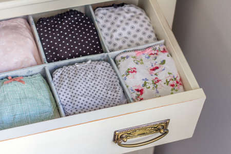 Female underwear with different patterns and lazes ordered in a personal wardrobe