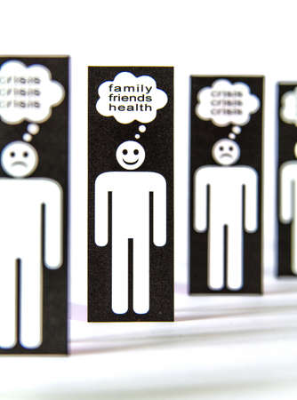 power failure: Line of negative paper men symbols thinking about crisis and one positive for the family, friends and health Stock Photo