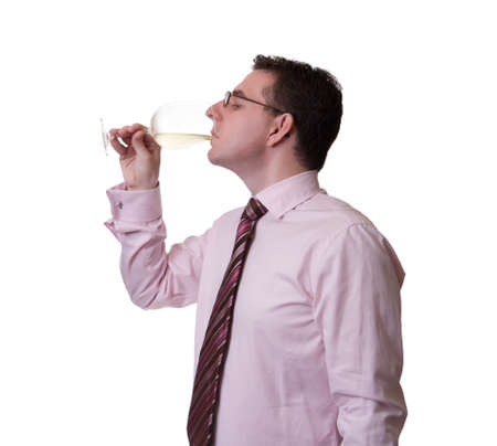 Portrait of a man with tie tasting a glass of white wine photo